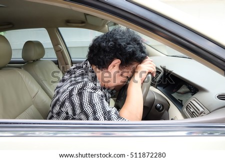 Senior woman sleeping in car