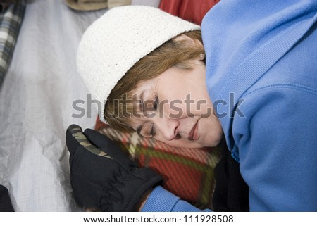 Senior woman sleeping in tent