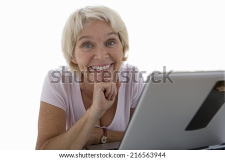 senior woman smiling by laptop computer, cut out