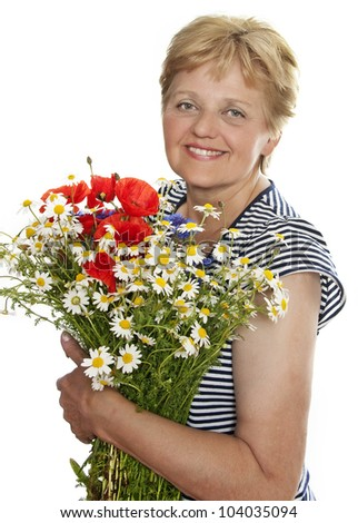 senior woman smiling with bunch of wild flowers isolated on white background