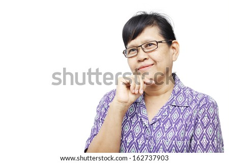 Senior woman smilingly and touching her chin