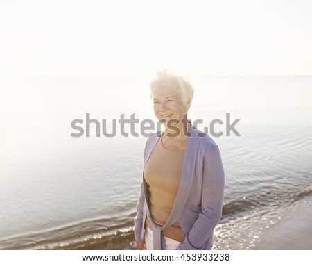 Senior woman spending time by the ocean