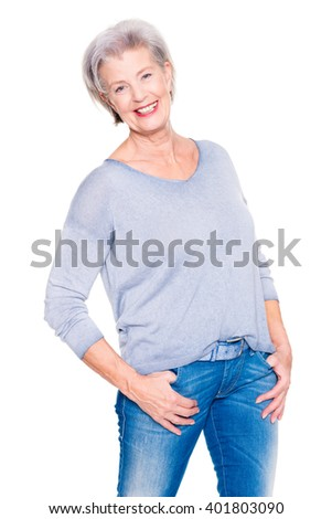 Senior woman standing in front of white background - stock photo