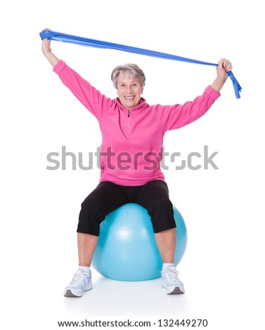 Senior Woman Stretching Exercising Equipment On White Background - stock photo