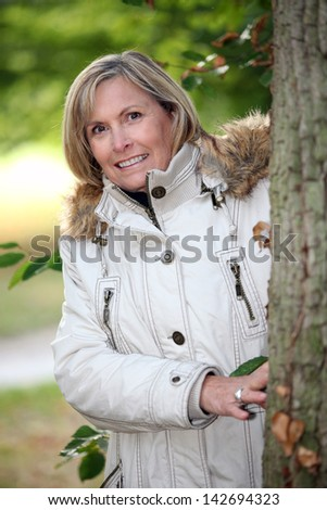 Senior woman strolling in the woods