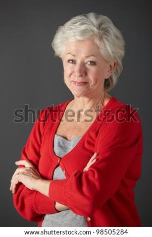 Senior woman studio portrait - stock photo