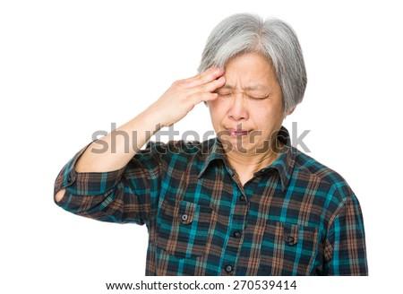 Senior woman suffer from headache - stock photo