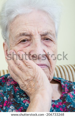 senior woman suffering a awful pain