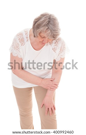 Senior woman suffers from arthrosis. All on white background - stock photo