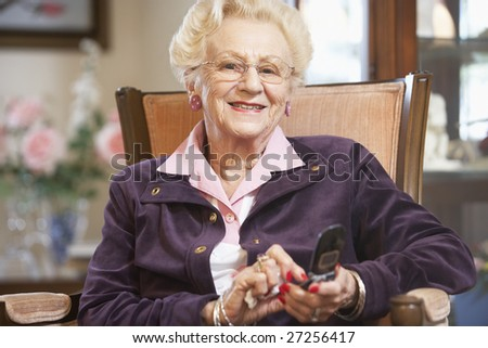 Senior woman text messaging - stock photo