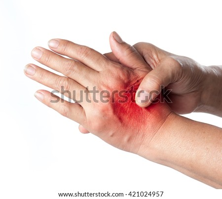 Senior woman touching her injured hand on white background,suffering pain concept