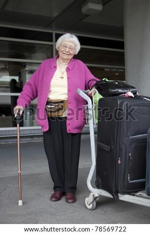 Senior woman travelling - stock photo
