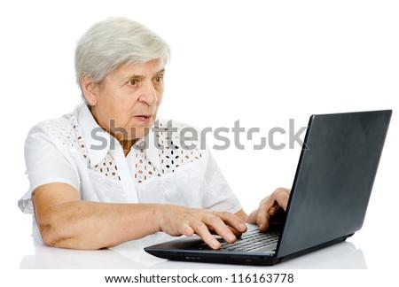 senior woman using laptop. isolated on white background - stock photo
