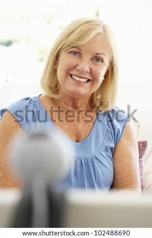 Senior woman using skype - stock photo