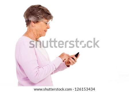 senior woman using smart phone isolated on white - stock photo