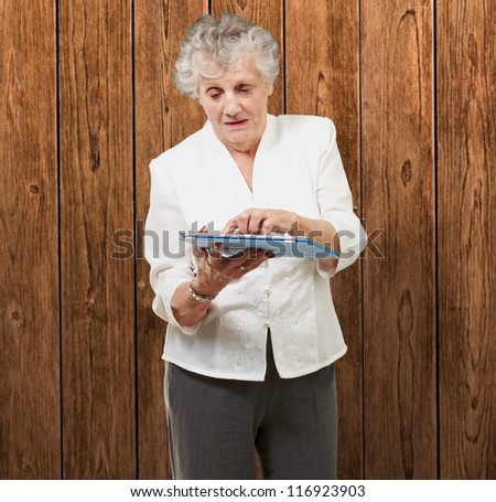 Senior woman using tablet, indoor