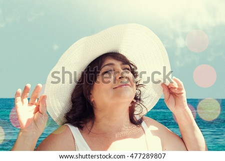 Senior woman wearing a hat. Vacation.