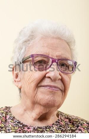 senior woman wearing eyeglasses - stock photo