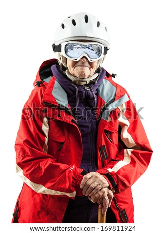 Senior woman wearing ski jacket and helmet over white background. With clipping path. - stock photo