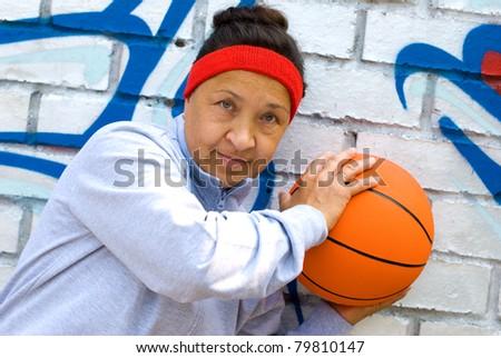 Senior woman with a basketball - stock photo