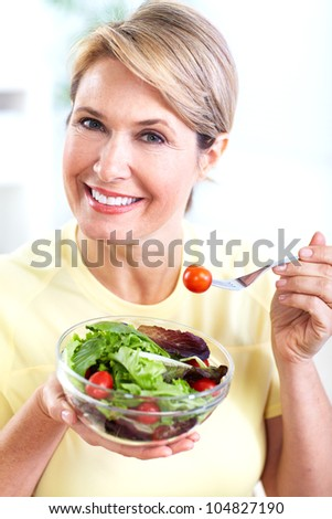 Senior woman with a salad. Diet. Healthy lifestyle. - stock photo
