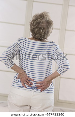 Senior woman with back pain - stock photo