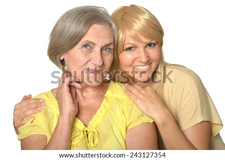 Senior woman with daughter on white - stock photo
