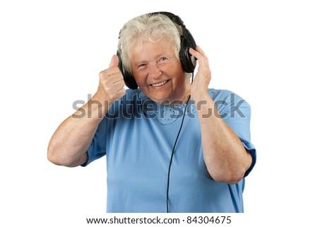 Senior woman with earphones is making OK gesture - stock photo