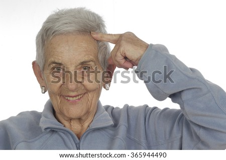 senior woman with finger on head - stock photo