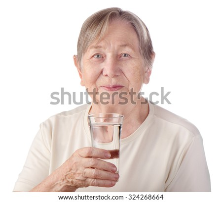 Senior woman with glass of water isolated on a white background - stock photo