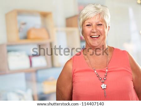 Senior Woman With Hands Behind, Indoor - stock photo