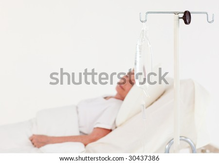 Senior woman with illness in hospital - stock photo