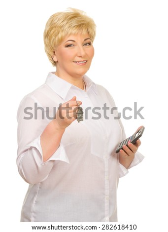 Senior woman with keys and calculator isolated - stock photo