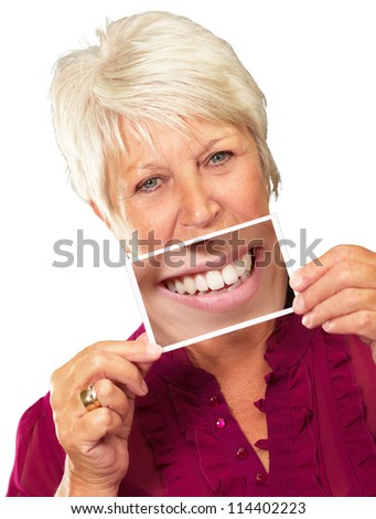 Senior Woman With Magnifying Glass Showing Teeth On White Background