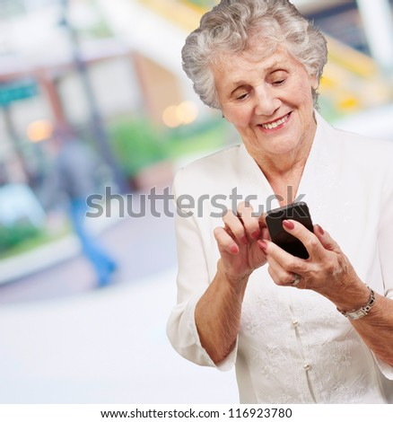 Senior woman with mobile phone, outdoor - stock photo