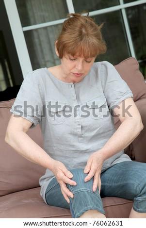 Senior woman with osteoarthritis pain - stock photo
