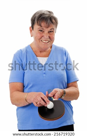 Senior woman with pingpong racket and ball - isolated - stock photo