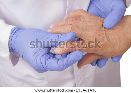 Senior woman with rheumatoid arthritis visit a doctor Isolated on white - stock photo