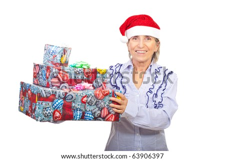 Senior woman with Santa hat holding Christmas gifts isolated on white background