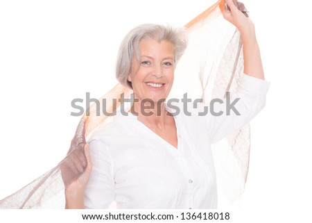 Senior woman with scarf in front of white background - stock photo