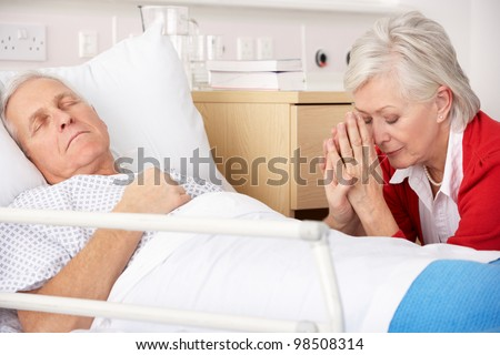 Senior woman with seriously ill husband in hospital - stock photo
