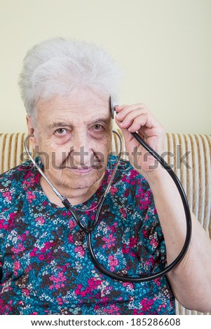 senior woman with stethoscope