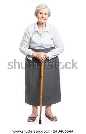 Senior woman with walking stick standing over white
