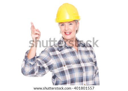 Senior woman with yellow helmet in front of white background
