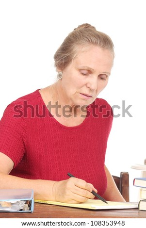 Senior woman writing on a note pad
