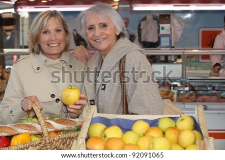 Senior women in the market - stock photo