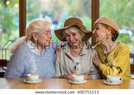 stock photo senior women laughing at table happy ladies in cafe friendship tested by years 600755513