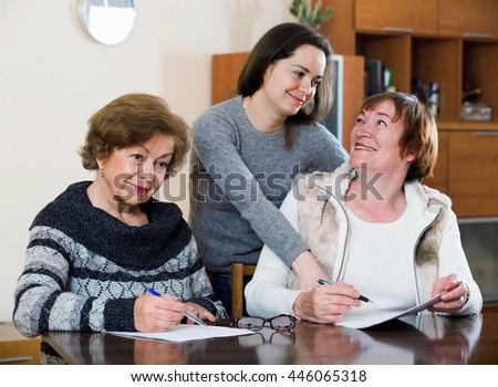 Senior women making will at public notary office and smiling