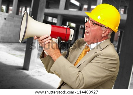 Senior Worker Shouting With Megaphone, Outdoor