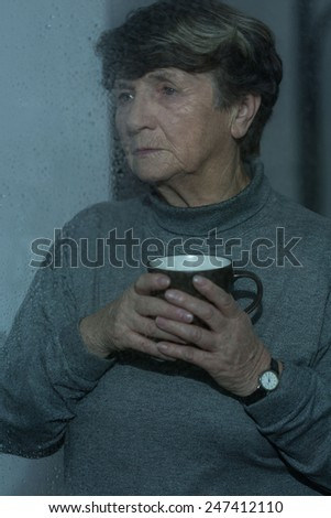 Senior worried lonely woman waiting for relatives - stock photo